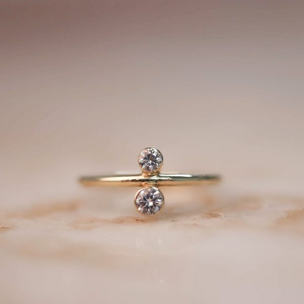 14k gold North South ring with Moissanite