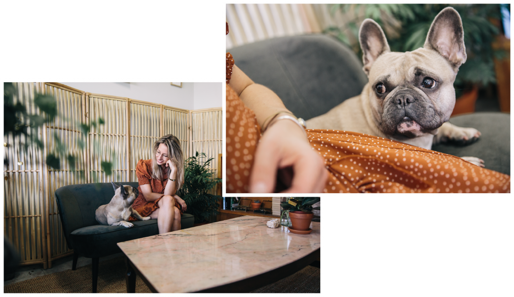 Goldsmith sitting on a couch in the studio of Bobini Roots with her french bulldog