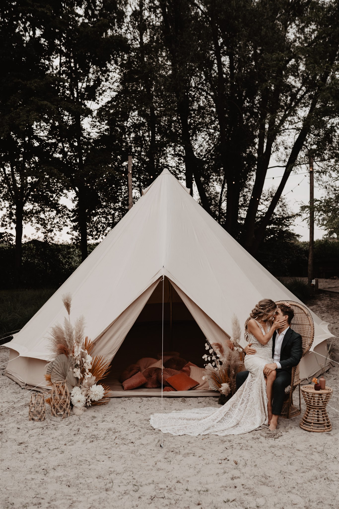Couple kissing by tent
