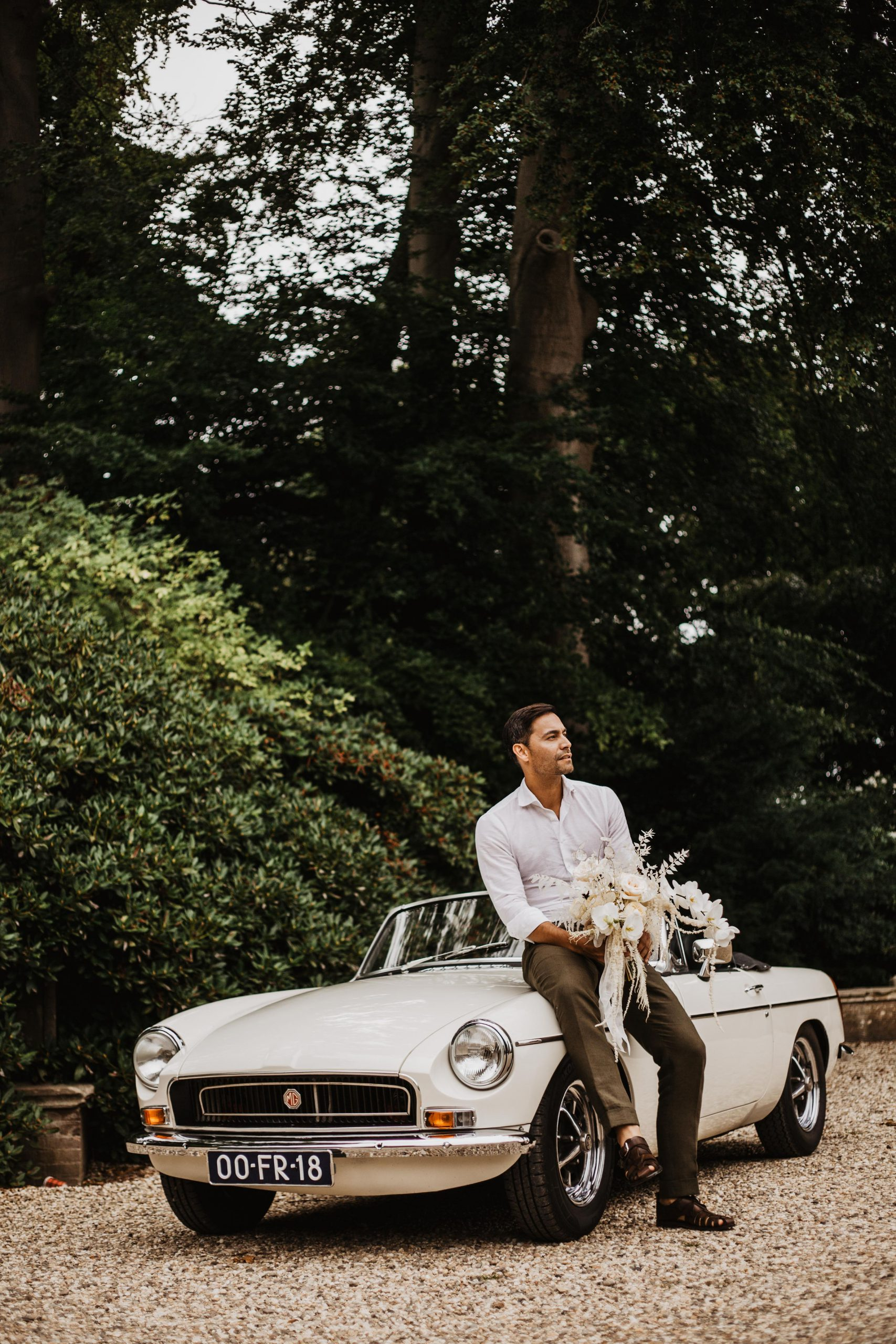 Groom waiting by the car