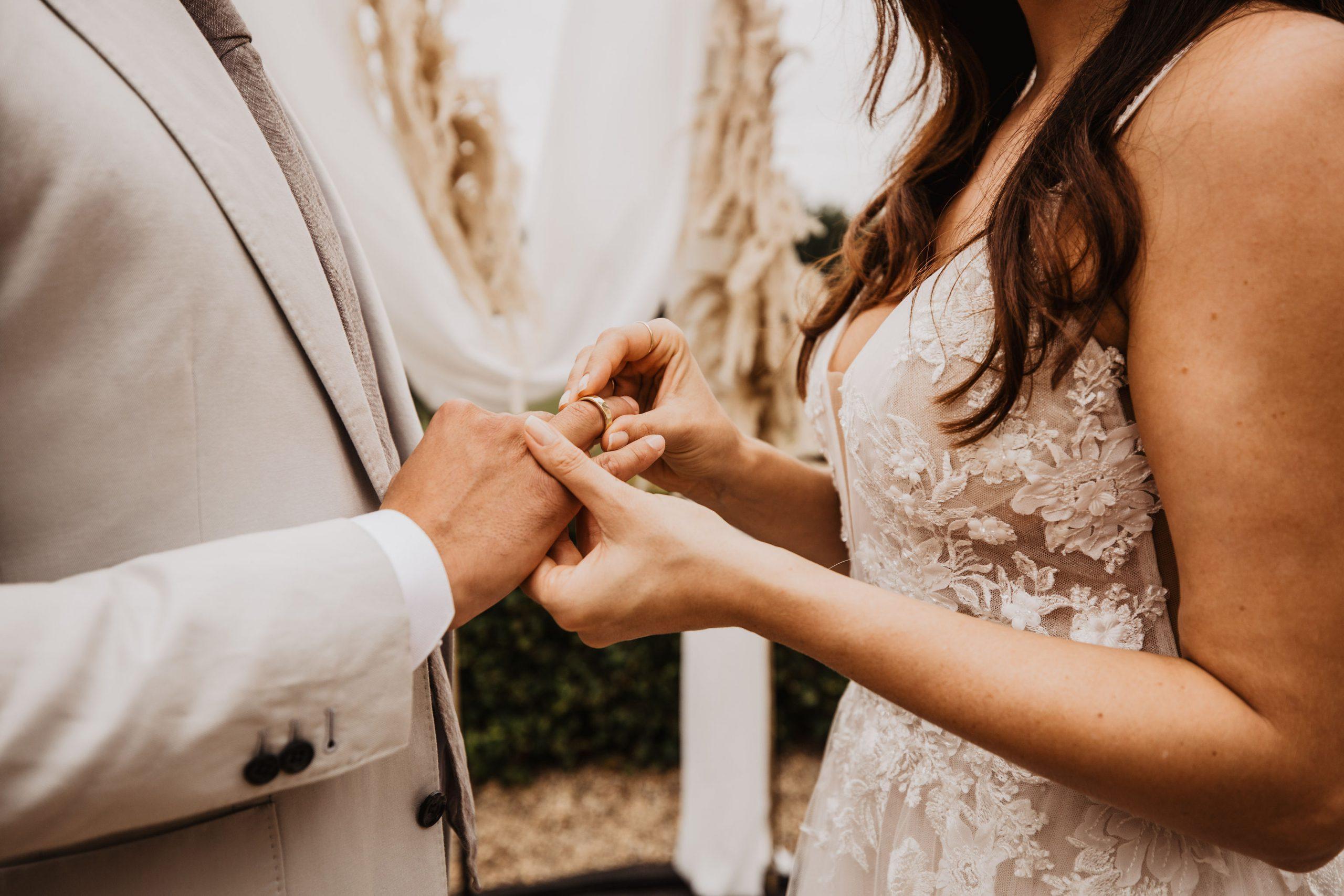 Putting on his wedding ring
