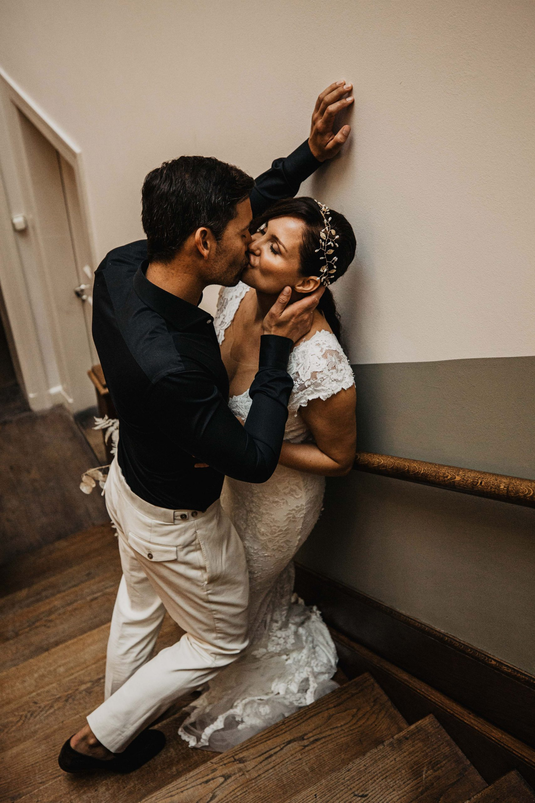 Couple kissing on a staircase